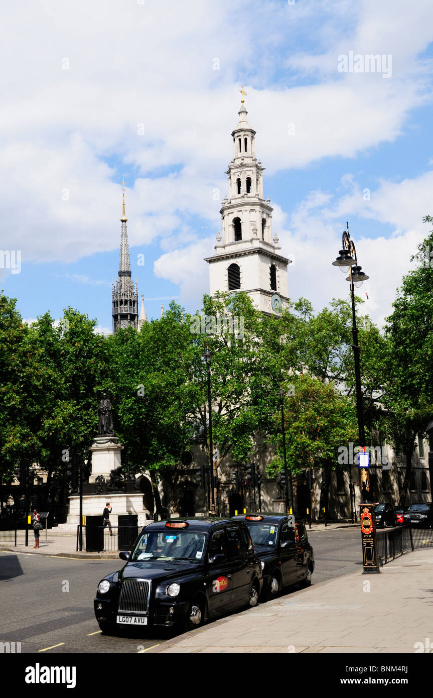 Black Cabs parked in The Strand near Aldwych,with Church of St Mary Le Strand London, England, UK - Stock Image