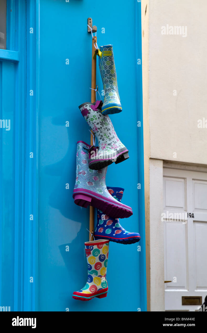 Display of fashionable colourful wellington boots outside a shop - Stock Image