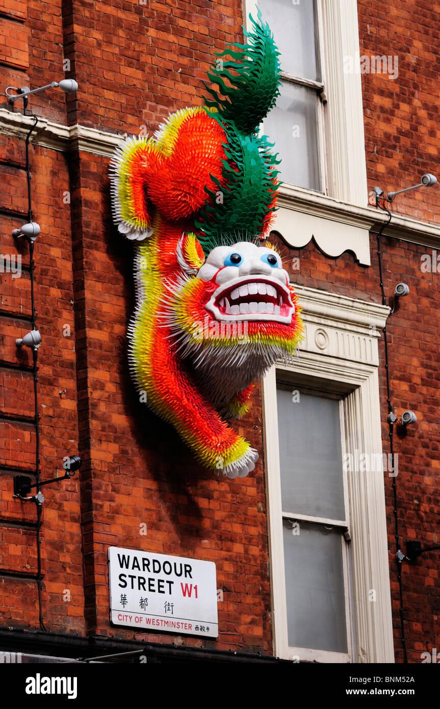 Chinese Dragon wall decoration, Wardour Street, Chinatown, London, England, UK - Stock Image