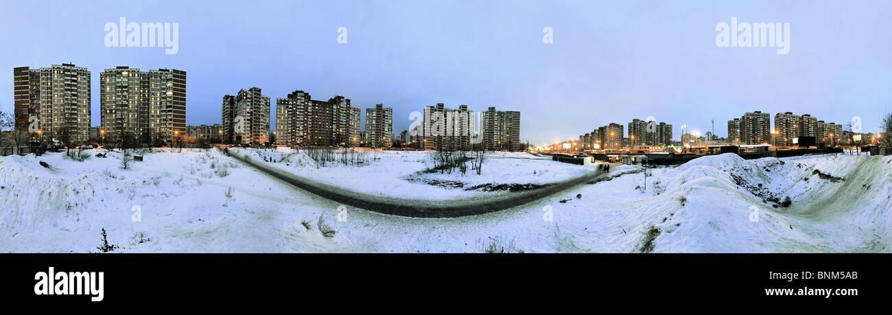 The Ukraine Kiev winter conurbation in the evening lights snow residential block flat construction concrete blocks - Stock Image