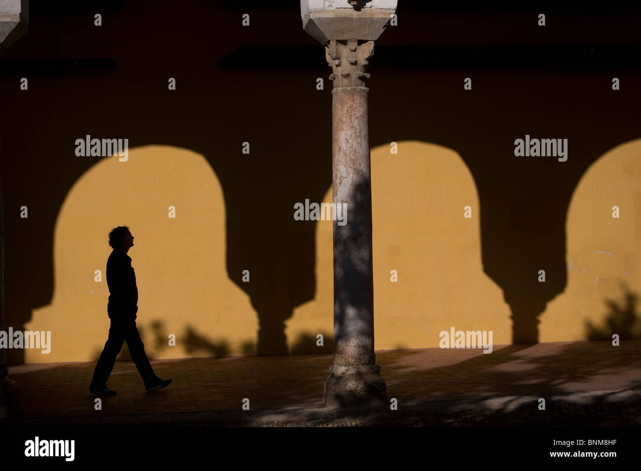 A tourist walks in the Mosque and Cathedral of Cordoba, Andalusia, Spain, April 27, 2010. Stock Photo