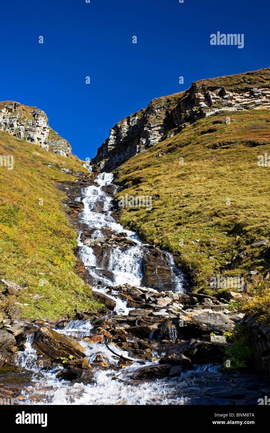 Austria Grossglockner pass high-level brook cliff alpine holidays travel, - Stock Image