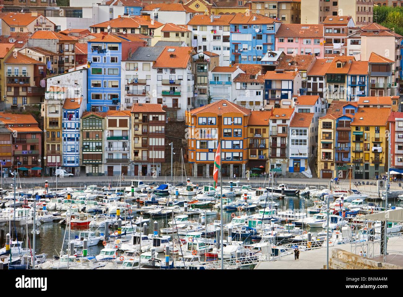 Spain Basque Provinces Bermeo harbour port village boats houses homes holidays travel, - Stock Image