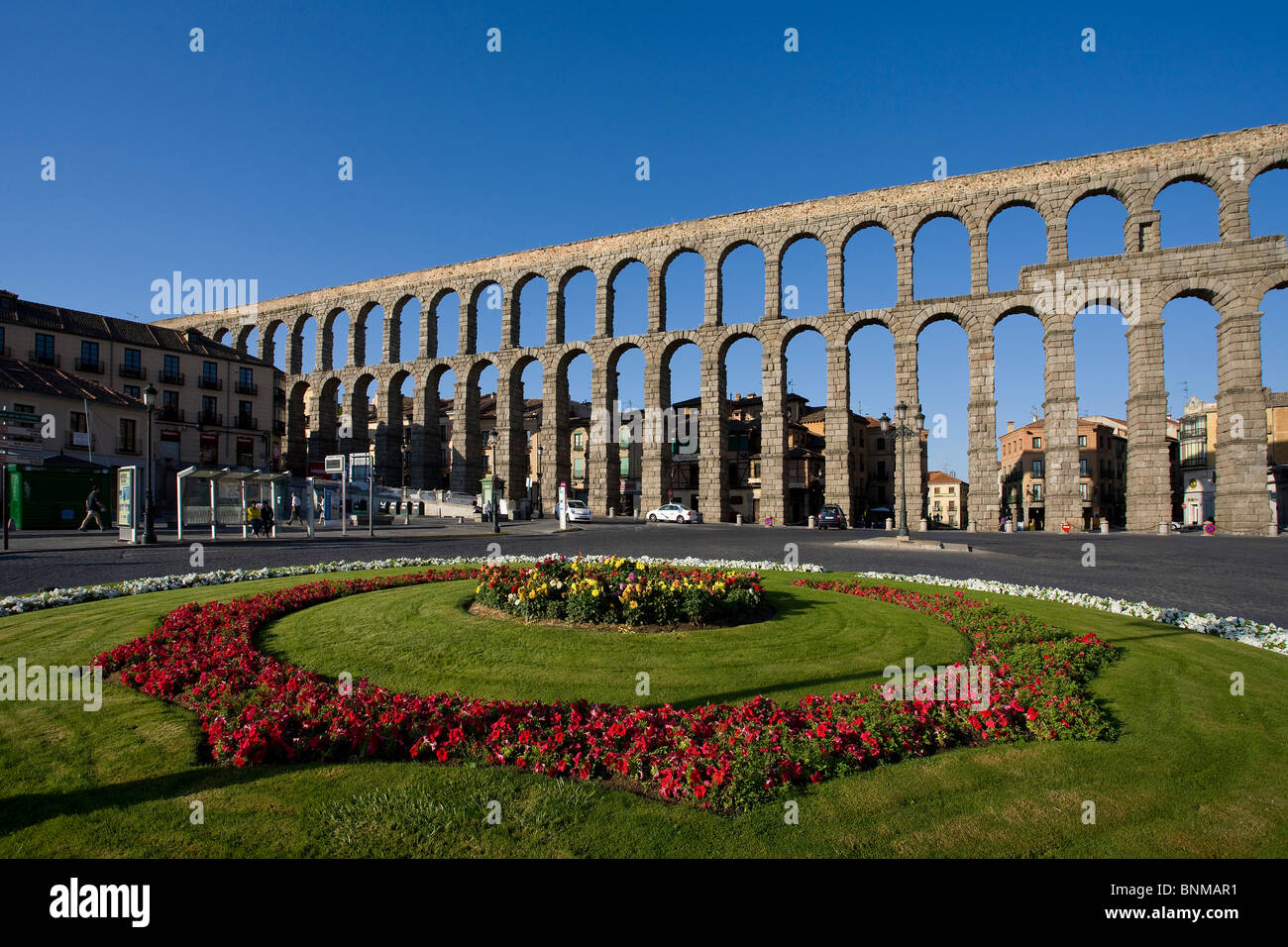 Spain Castile and Leon Segovia aqueduct Roman place space flowers holidays travel, - Stock Image