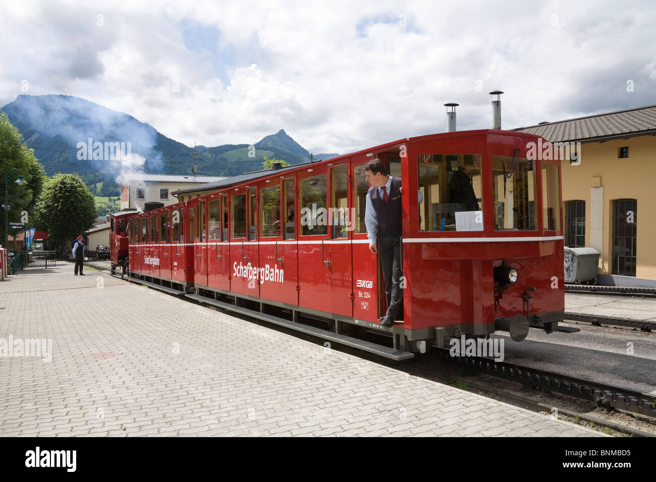 St Wolfgang Upper Austria Driver waiting for guard to signal small cog railway train is ready to depart up Schafberg - Stock Image