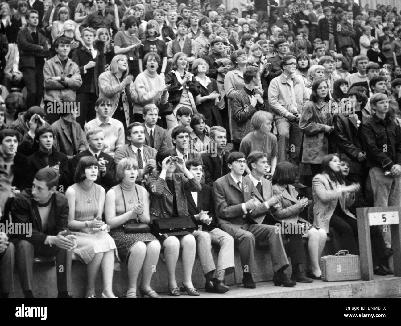 1960th 1966 Sixties follower fans excitement beat concert the Beatles enthusiasm Germany emotions Essen Grugahalle - Stock Image