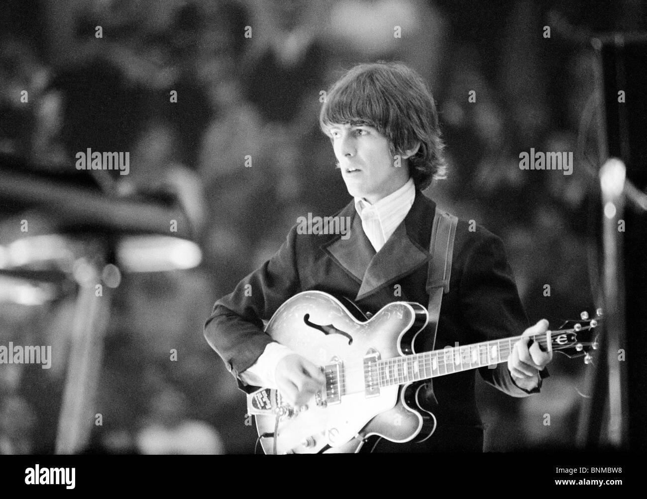 The Beatles music pop group band concert Germany Essen 1966 George Harrison guitar guitarist - Stock Image
