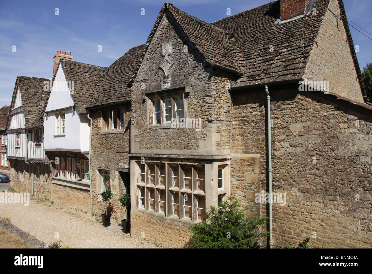 Three beautiful original medieval houses in Lacock village ,Wiltshire in England. - Stock Image
