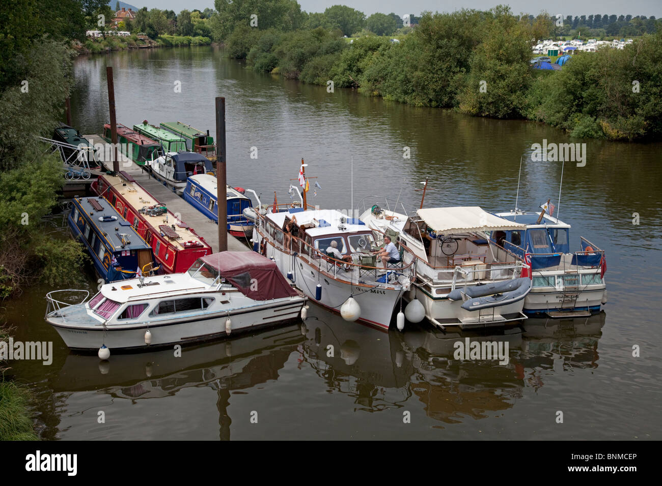 Motor launches and houseboats moored on River Severn Upton upon Severn UK - Stock Image