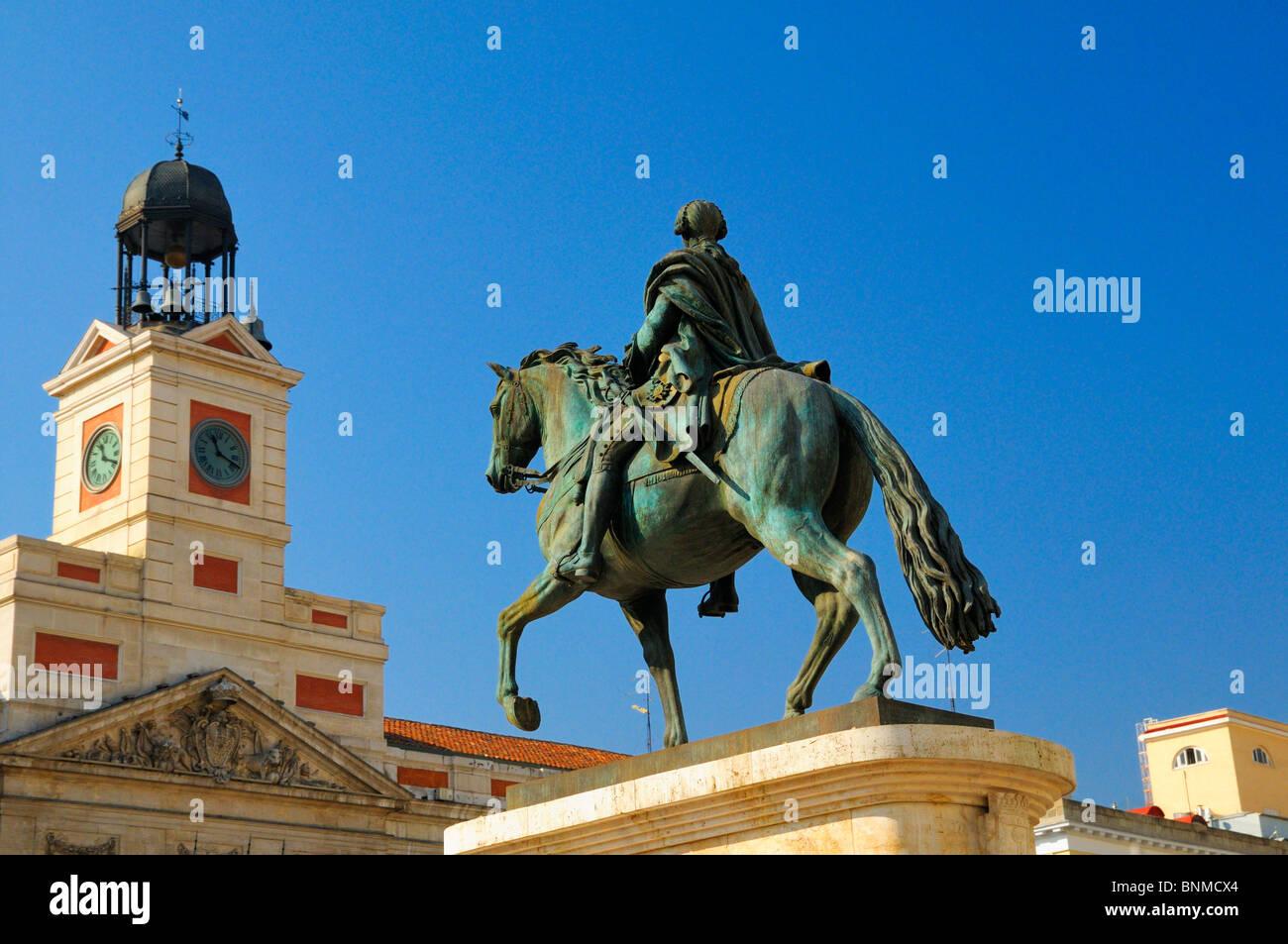 Equestrian statue of King Carlos III and clock tower of Real Casa de Correos, Puerta del Sol, Madrid, Spain Stock Photo