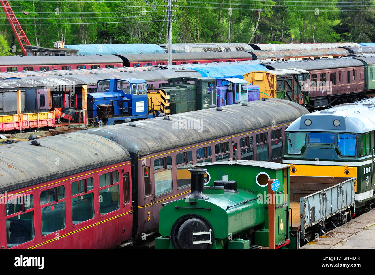 Locomotives and carriages at the Boat of Garten railway station, Scotland, UK - Stock Image