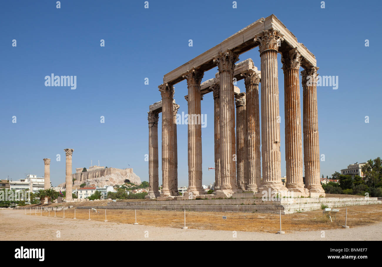 The Temple of Olympian Zeus in Athens with the acropolis visible in the background. View from the southeast. - Stock Image