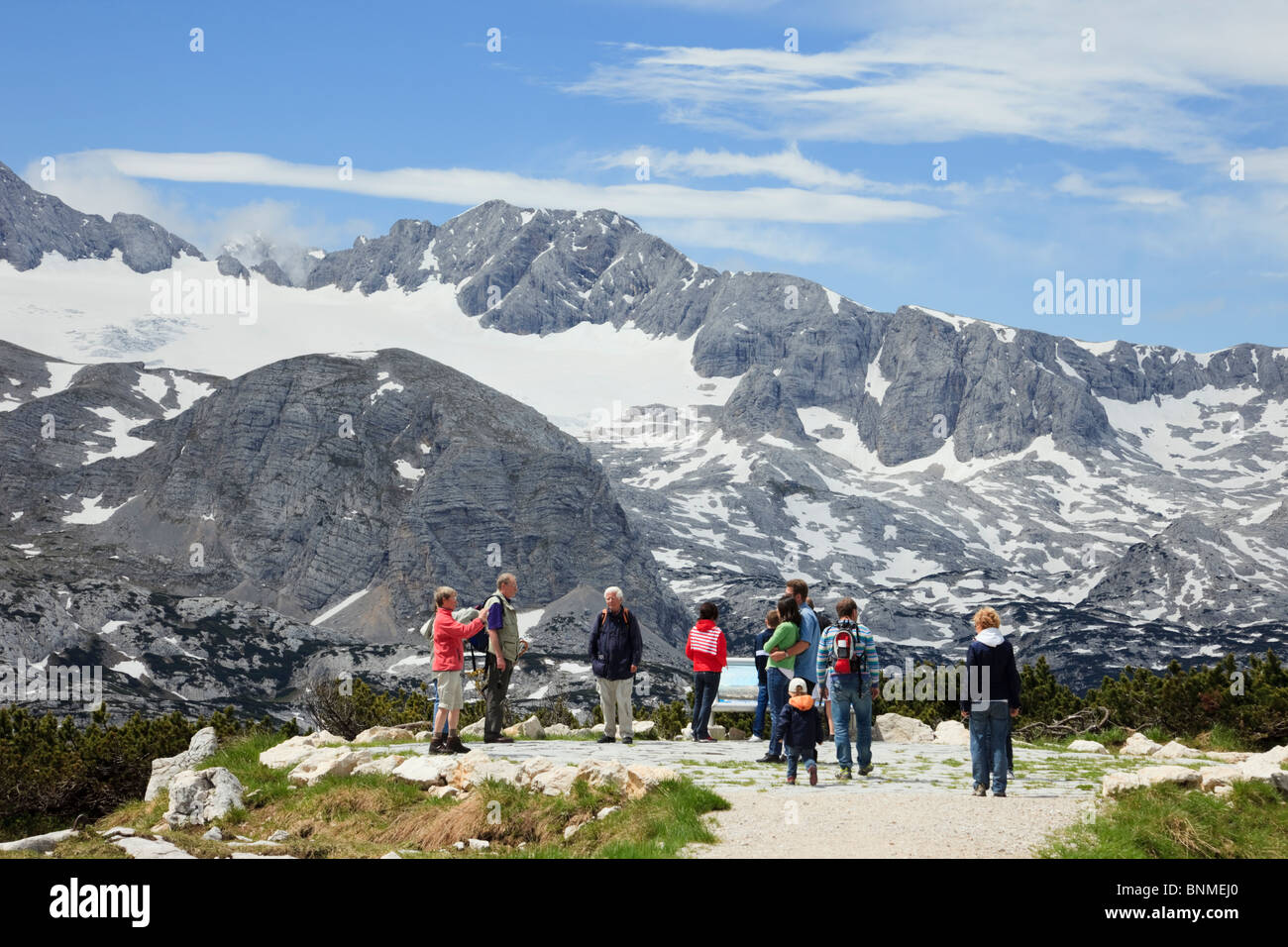 People at the WorldNaturalHeritage viewpoint on Krippenstein mountain in the Dachstein Massif in the Alps in Austria - Stock Image