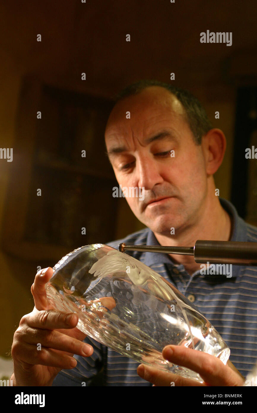 Ireland, Waterford, Waterford Crystal Factory Visitor's Centre, craftsman engraving glass - Stock Image