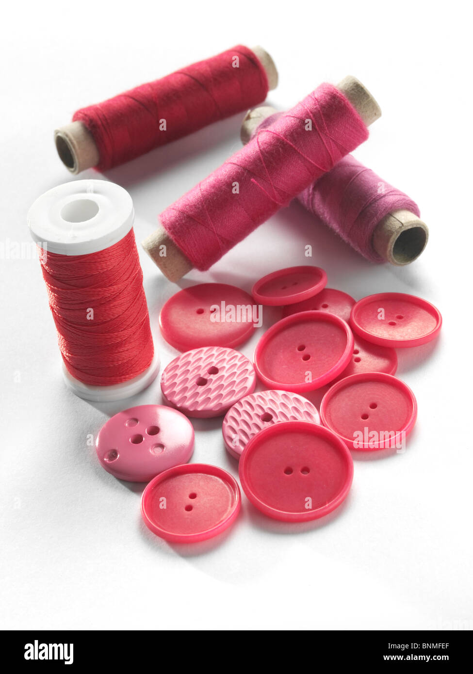 red,buttons,thread,sewing - Stock Image