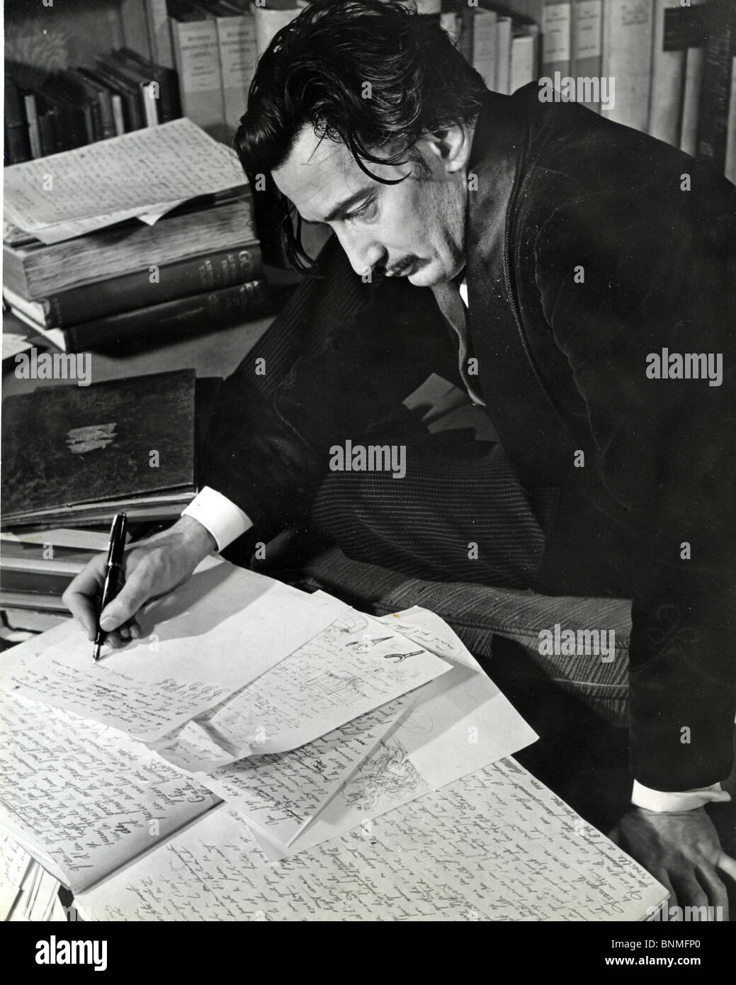 SALVADOR DALI  (1984-89) Spanish artist writing his autobiography in 1940. See Description below Stock Photo