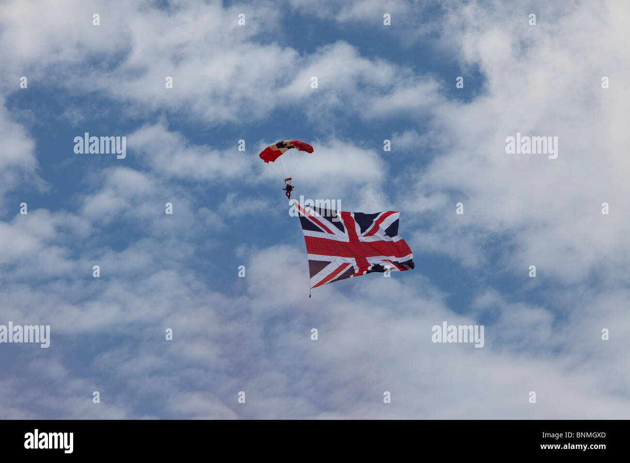 Parachute Regiment Free Fall team red devils flying a union jack. Farnborough air show 2010 uk. - Stock Image