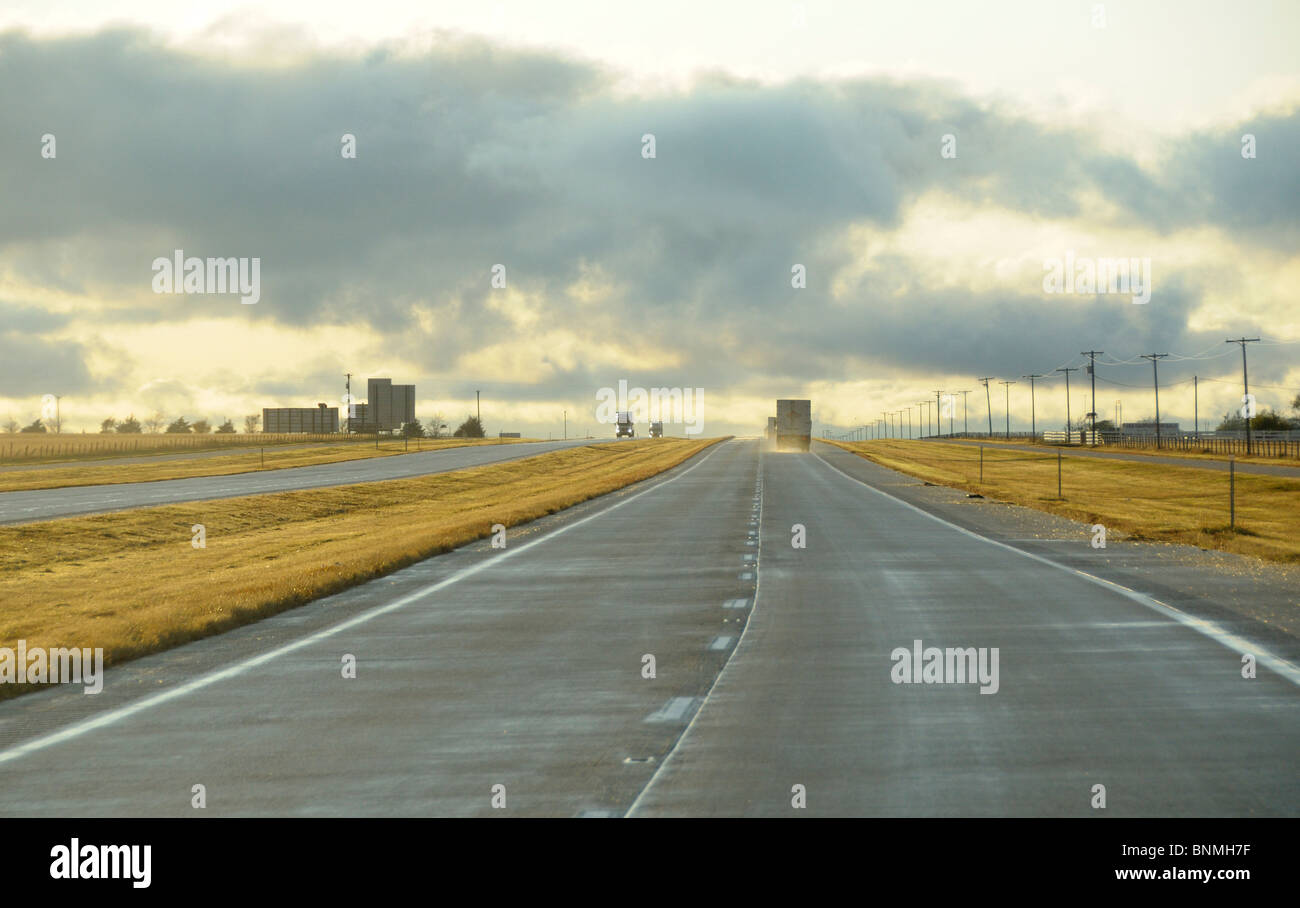 Storm driving trucks Highway I-40 route near Groom perspective dark clouds Texas USA America North America - Stock Image
