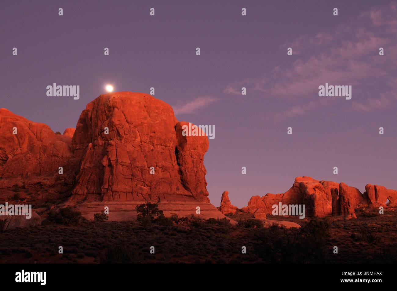 Moonrise dusk Window section rock formations Nature Landscape Arches National Park National Park near Moab Utah - Stock Image