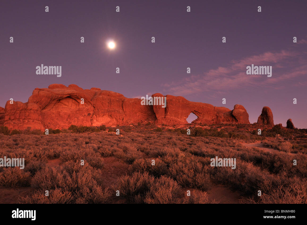 Moonrise dusk Window section rock arch formations Nature Landscape Arches National Park National Park near Moab - Stock Image