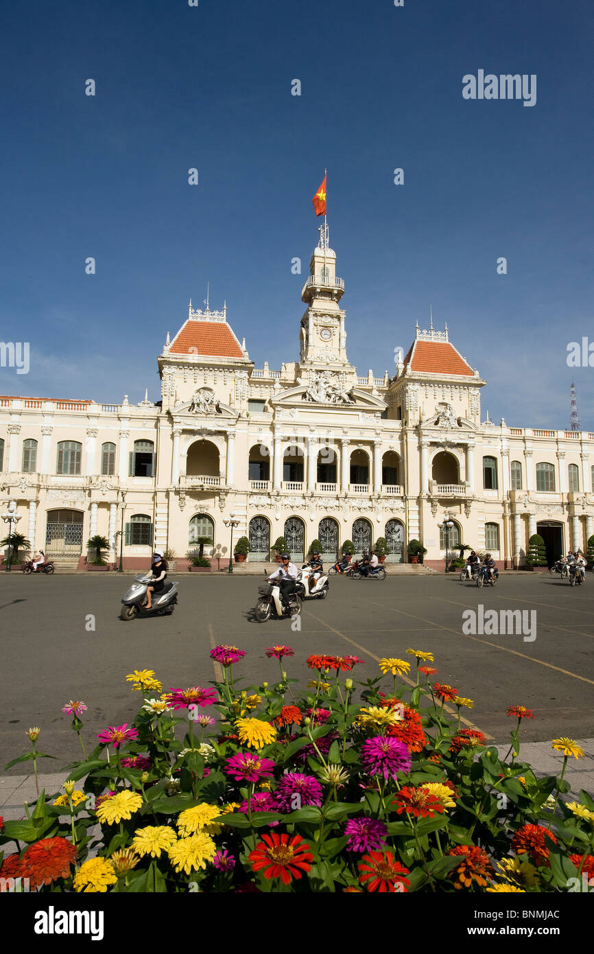 Saigon Ho Chi Minh town city Vietnam place space city hall communism flowerbed Asia traveling place of interest - Stock Image