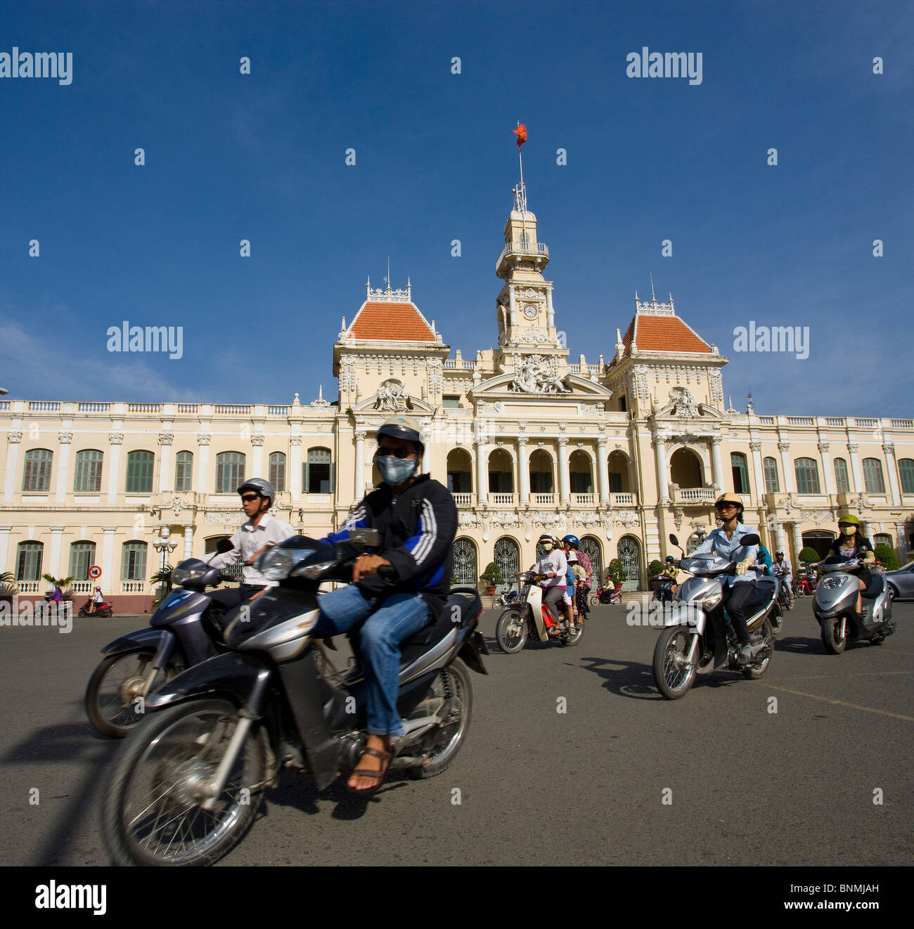 Saigon Ho Chi Minh town city Vietnam place space city hall motorcycles motorbikes traffic Asia traveling place of - Stock Image