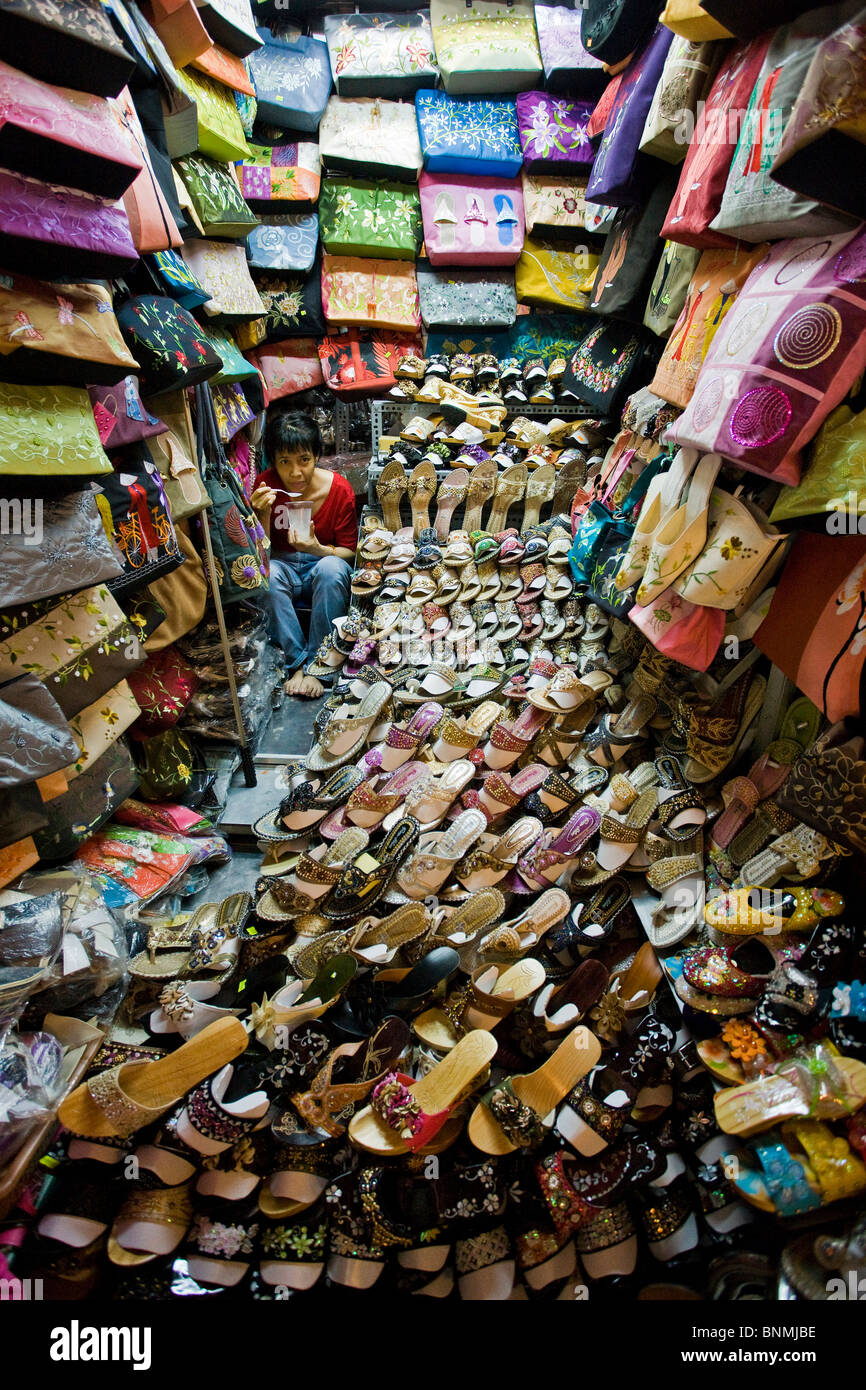 Saigon Ho Chi Minh town city Vietnam market Ben Tanh Asia shoes materials substances traders travel place of interest Stock Photo