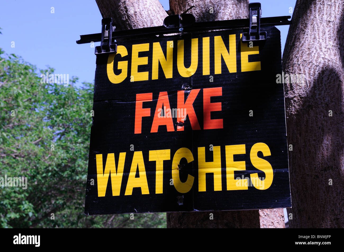 Genuine Fake Watches sign in a Turkish market Turkey Asia Minor - Stock Image