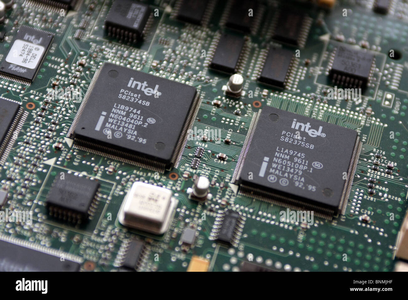 Computer PCB with two Intel PCI CPU control chips surface mounted on ...