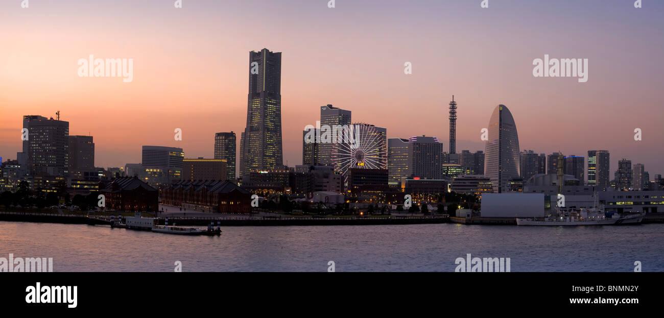 Japan Asia Far East Yokohama land mark of Building skyline building construction dusk twilight evening traveling - Stock Image