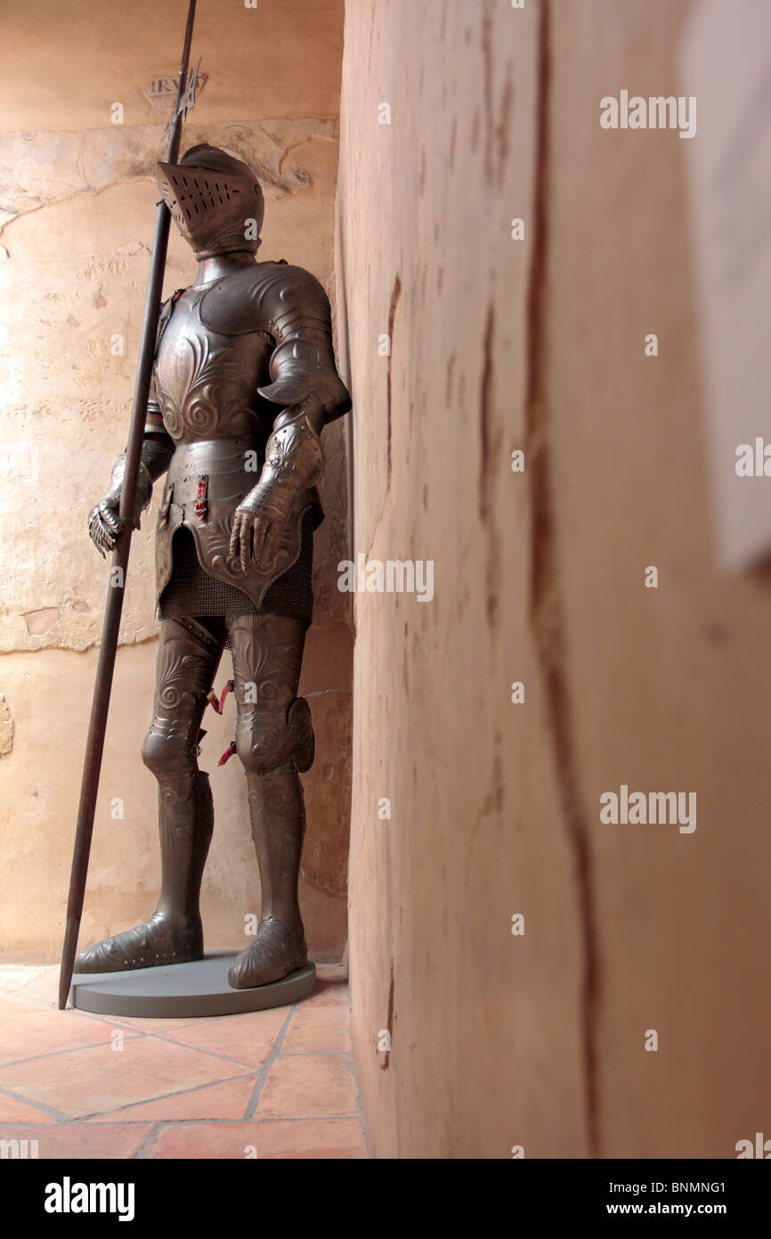 A medieval suit of armor on display in the Casa de los Tiros museum in Granada Andalucia Spain Europe - Stock Image