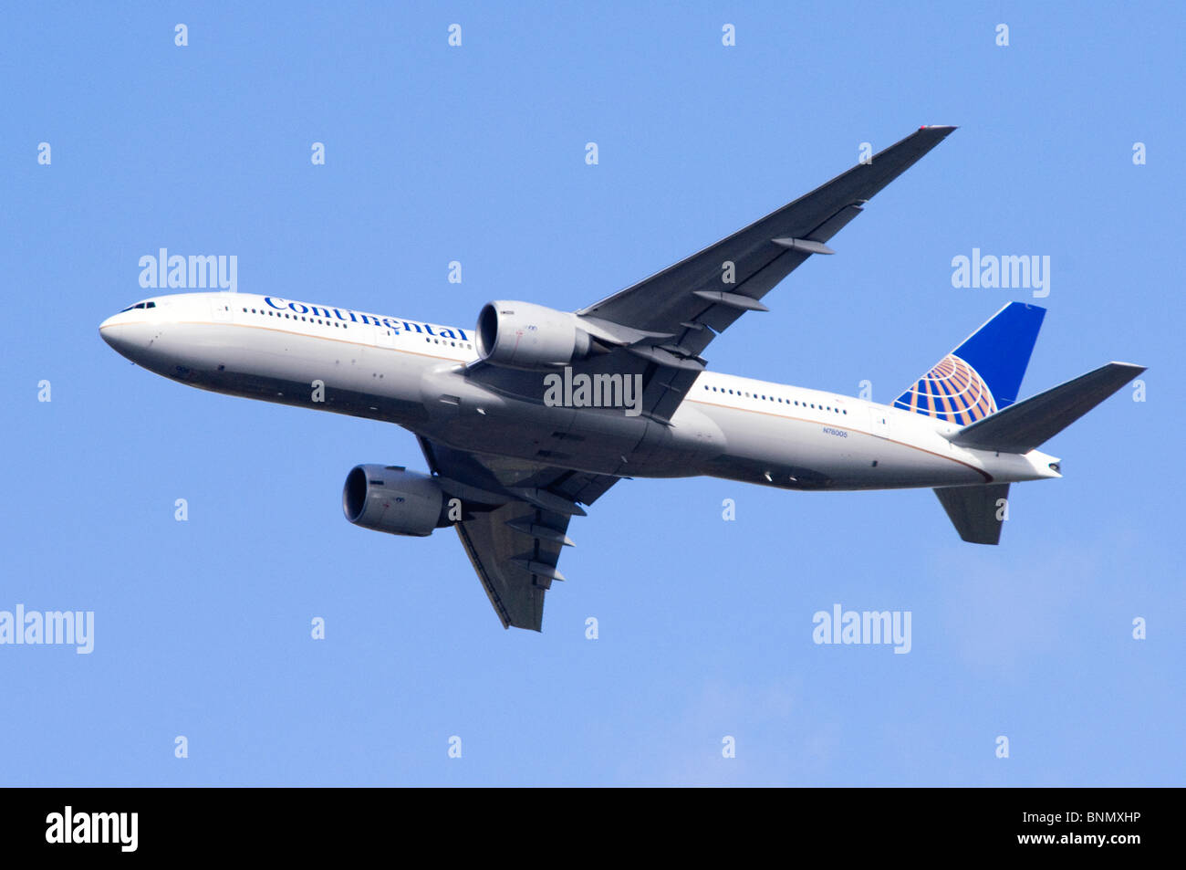 Boeing 777 operated by Continental Airlines climbing out after take off from London Heathrow Airport, UK. - Stock Image