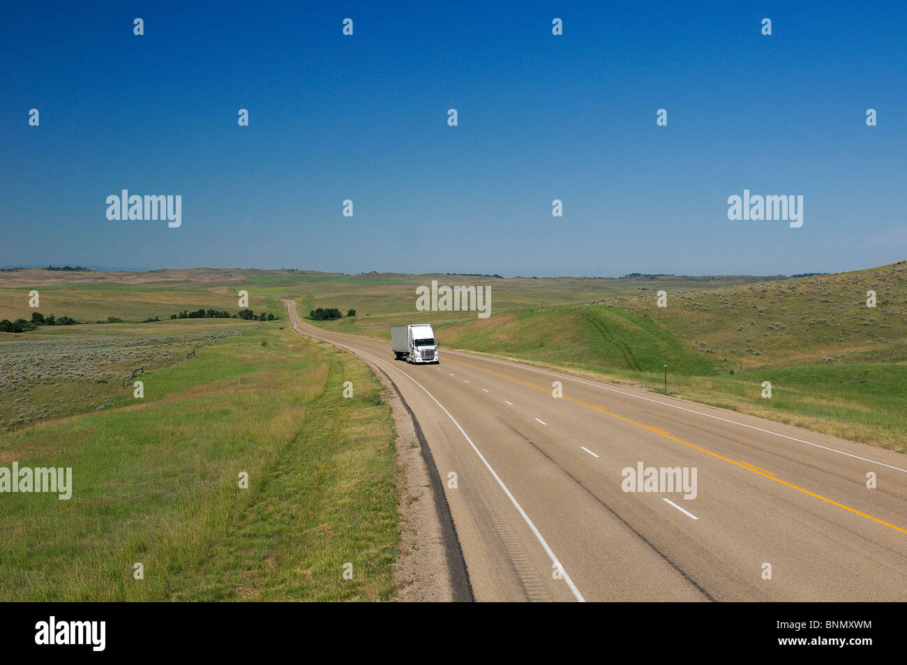 Truck Highway 212 Crow Agency Crow Indian Reservation Montana USA fields - Stock Image