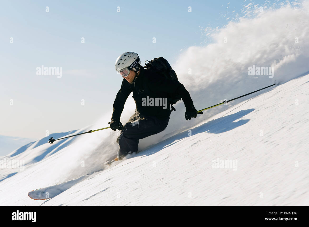 A backcountry skier carving through the powder in Hatcher Pass, Alaska Stock Photo