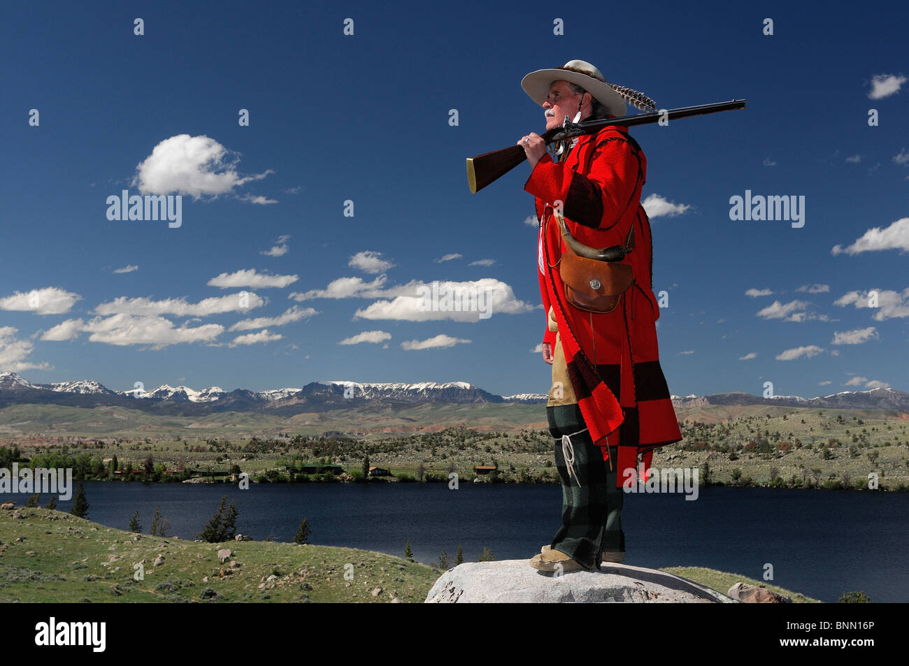 Re-enactor Steve Banks in mountain man costume with rifle Dubois Wyoming USA wild west - Stock Image