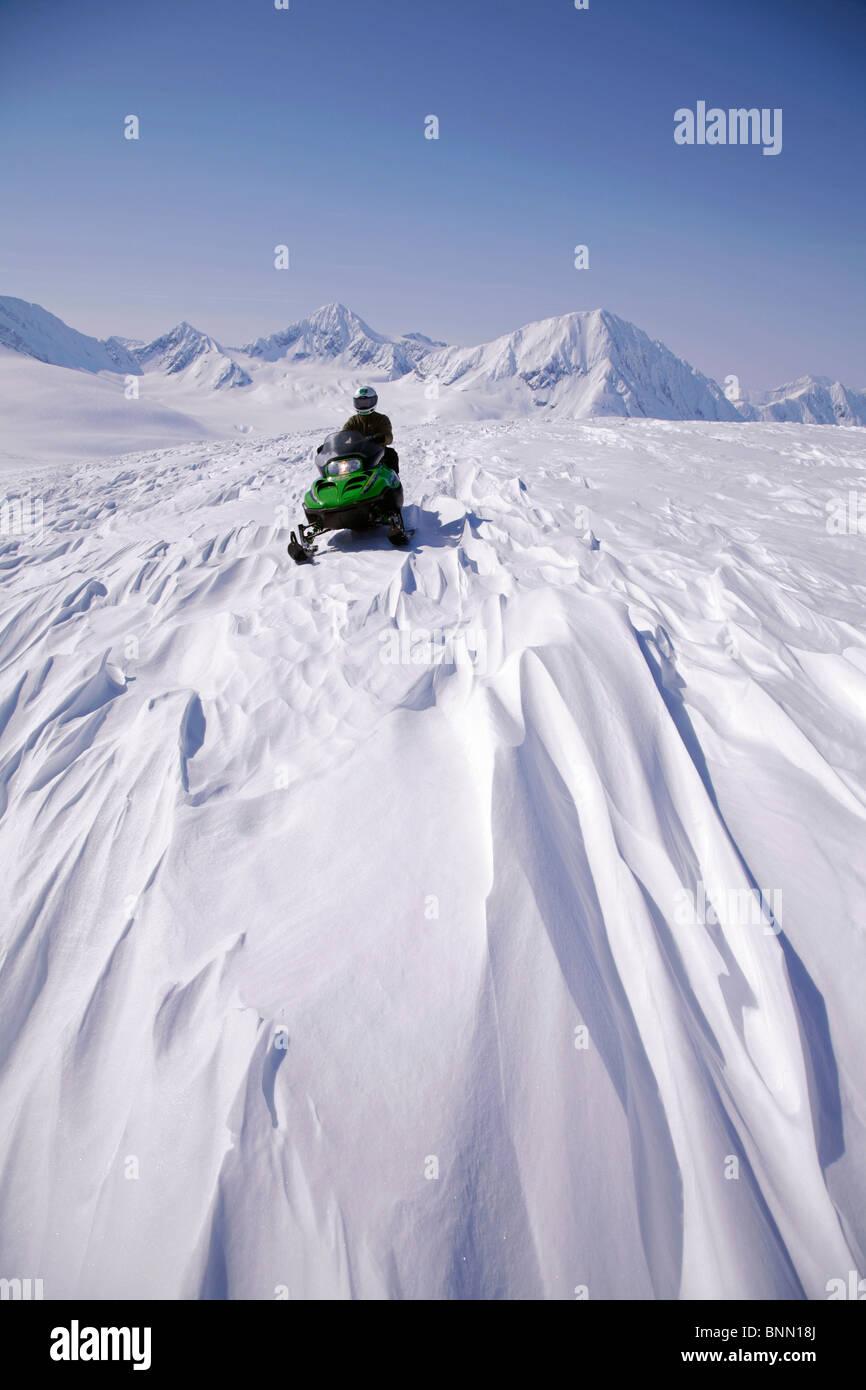 Snowmobiler on Spencer Glacier near the top of Blackstone Glacier, Kenai Mountains, Chugach National Forest, Alaska - Stock Image