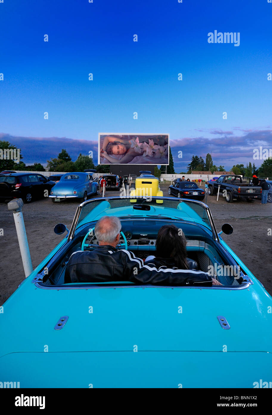 man woman couple classic car 1955 T-Bird Motor Vu Drive In Dallas Oregon USA cinema parking - Stock Image