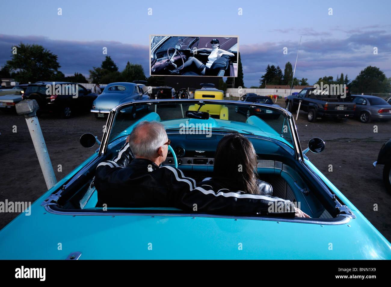 man woman couple classic car 1955 T-Bird Motor Vu Drive In Dallas Oregon USA cinema parking, - Stock Image