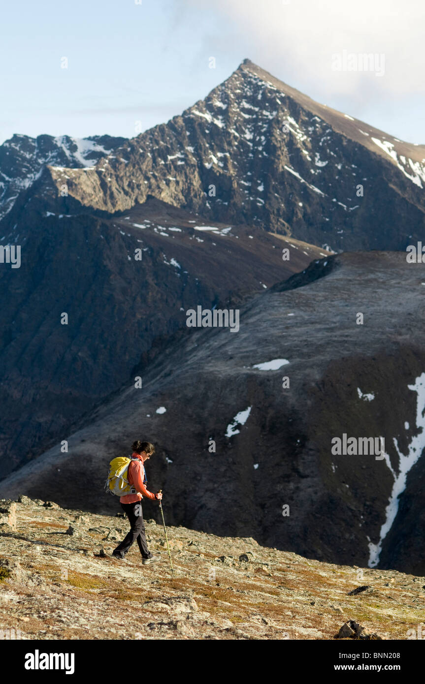 Woman hiking in Chugach State Park with *The Ramp* peak in the background, Alaska - Stock Image