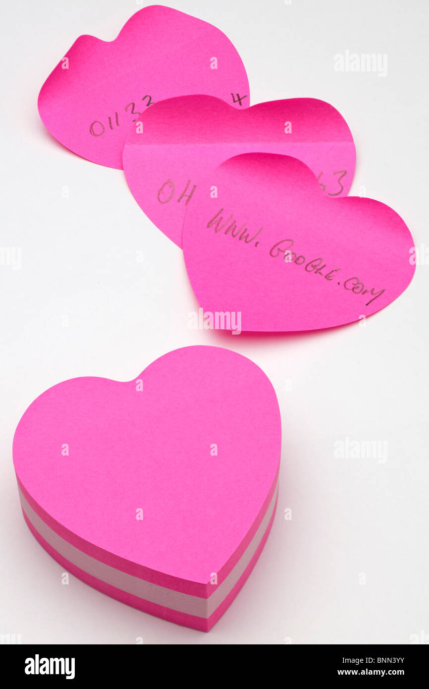 Heart shaped notepad and notes - Stock Image