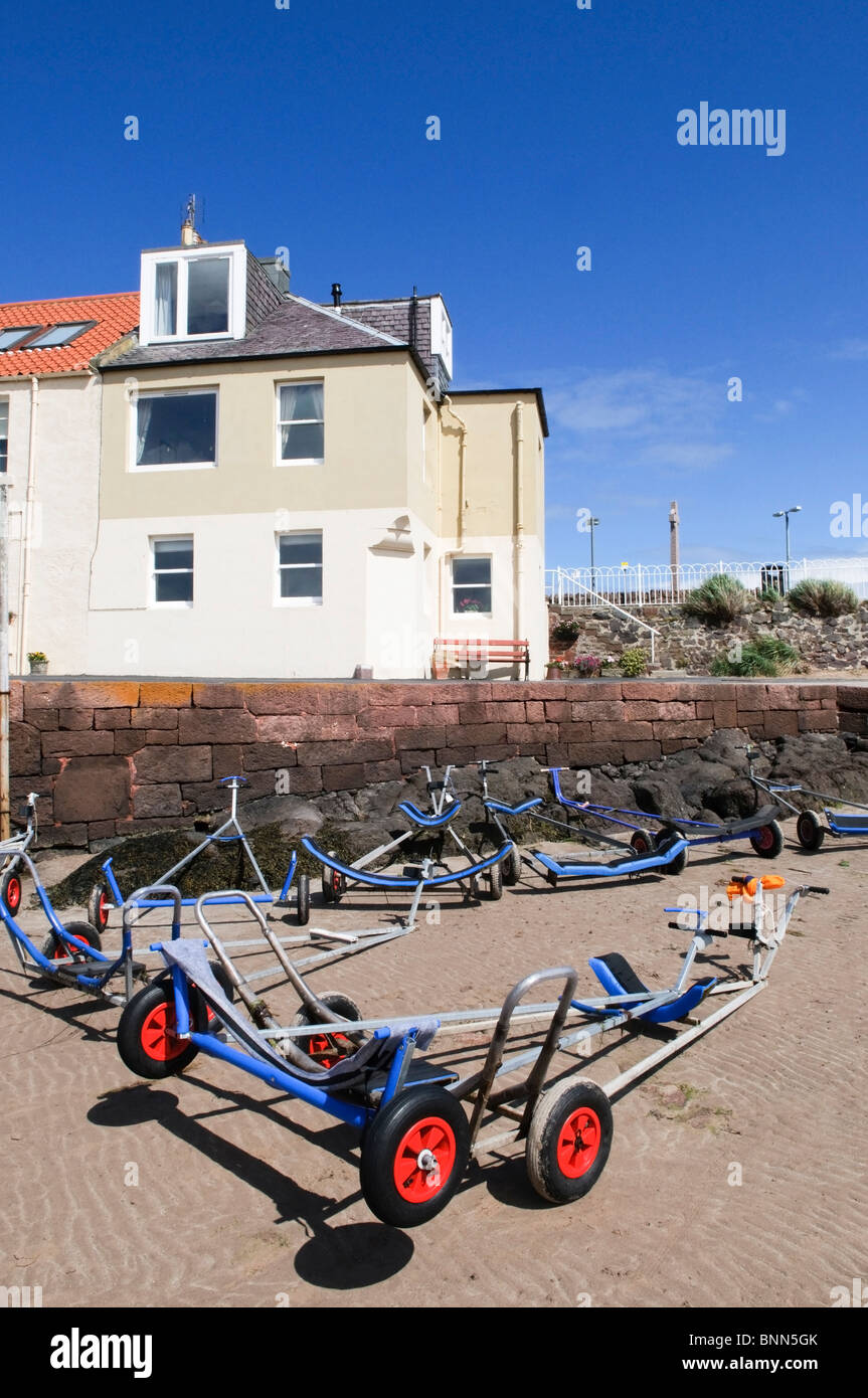 Dinghy trailers on the beach at North Berwick, Scotland. - Stock Image