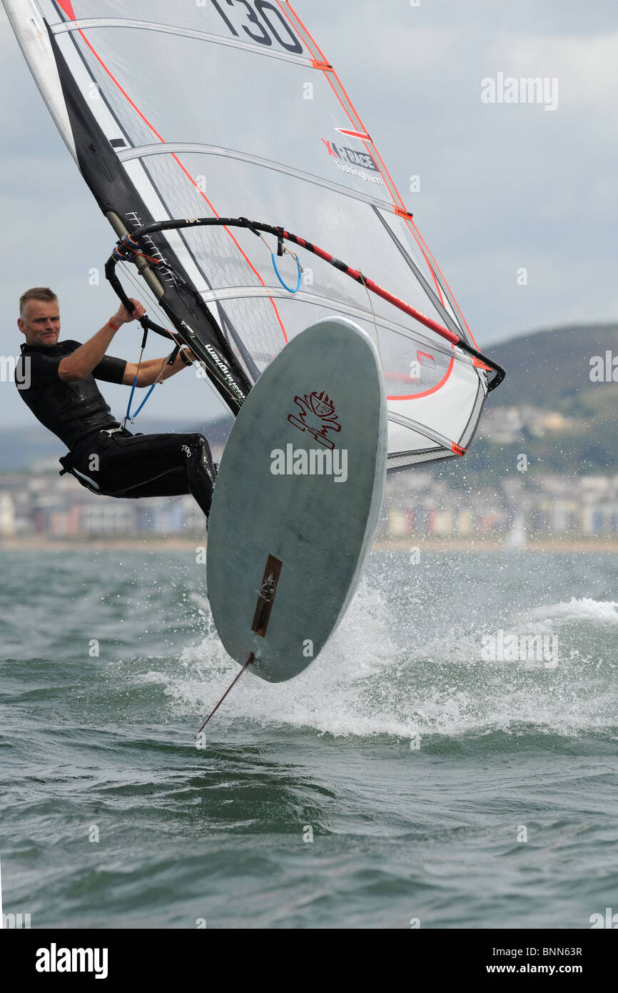 windsurfer caught in mid flight in Swansea Bay, site of Tidal Lagoon Stock Photo