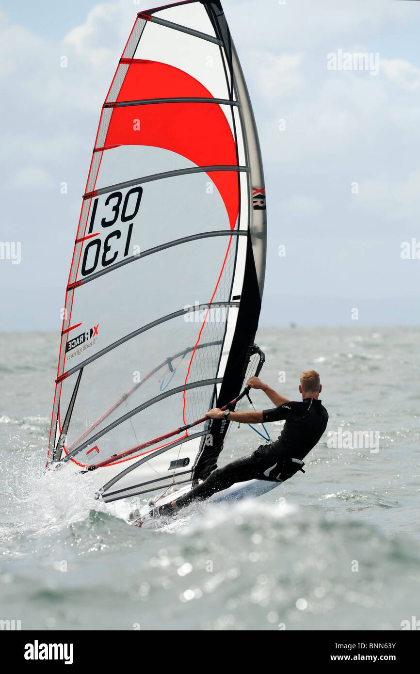 Course board   windsurfer racing at full tilt in Swansea Bay, site of Tidal Lagoon Stock Photo