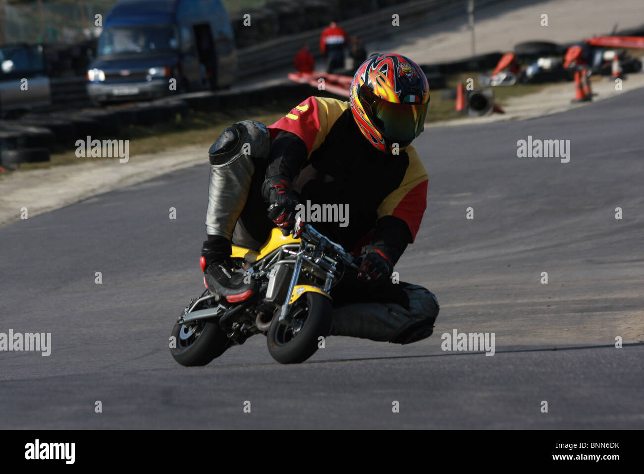 A Man Racing On A Mini Moto On A Race Way   Stock Image