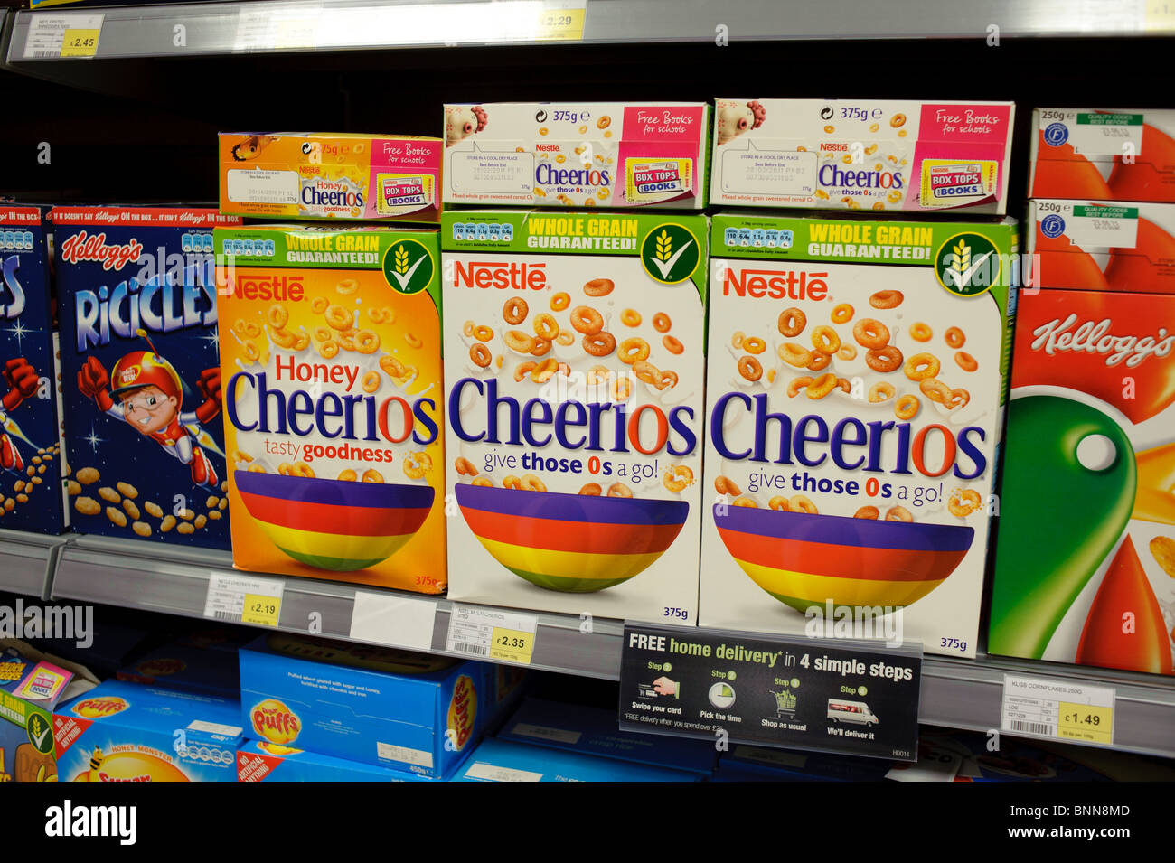 Packets of Nestle Cheerios breakfast cereals on a shelf in Co-Op supermarket, UK - Stock Image