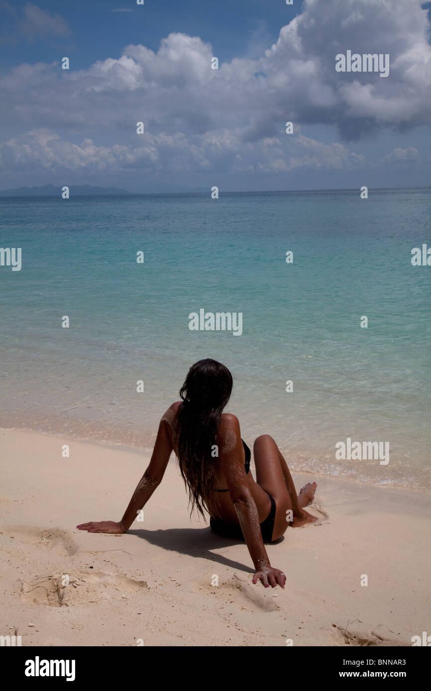 A female sunbather on a beach, Bamboo Island, Thailand Stock Photo