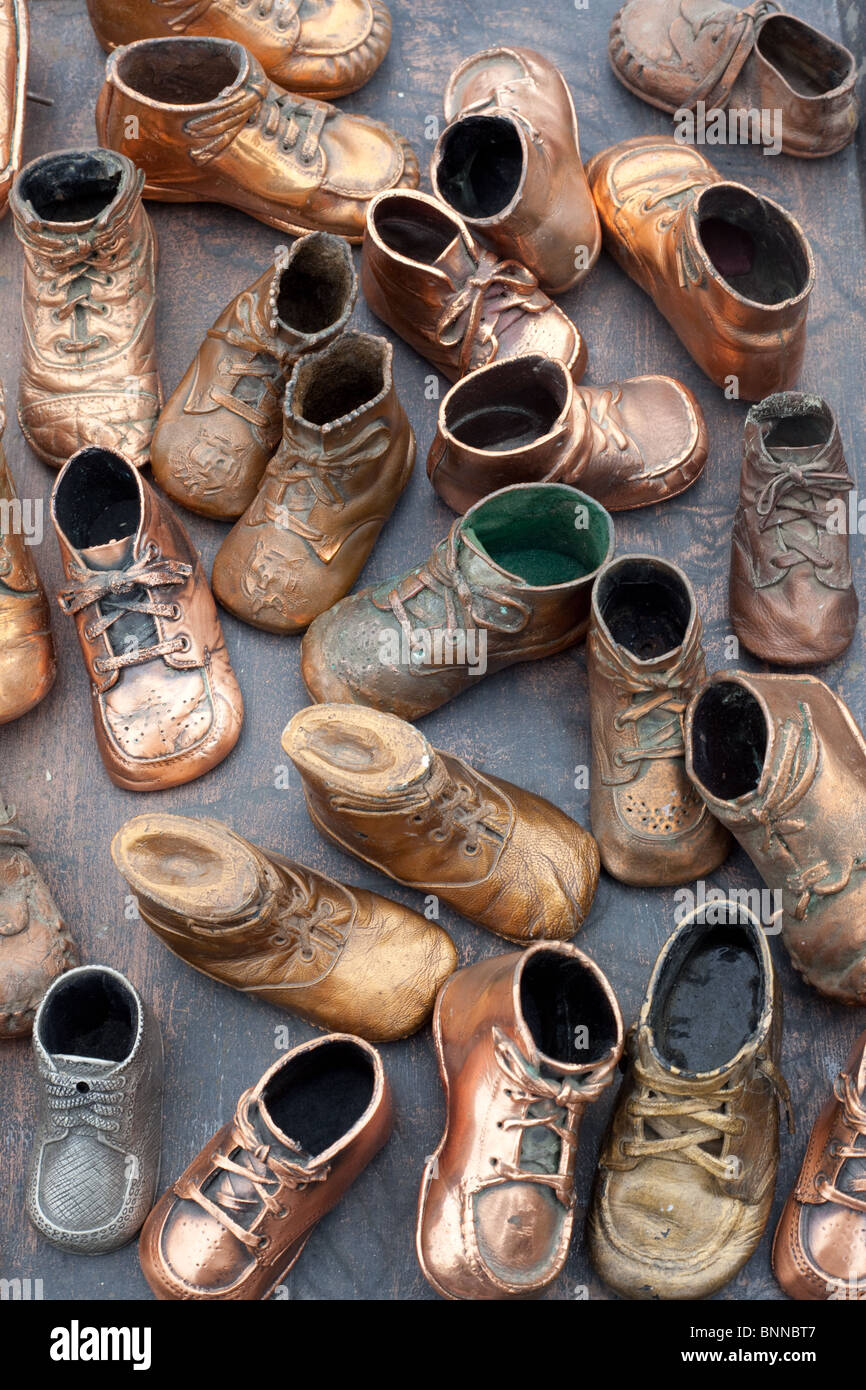 Assorted collection of toy metal shoes. - Stock Image