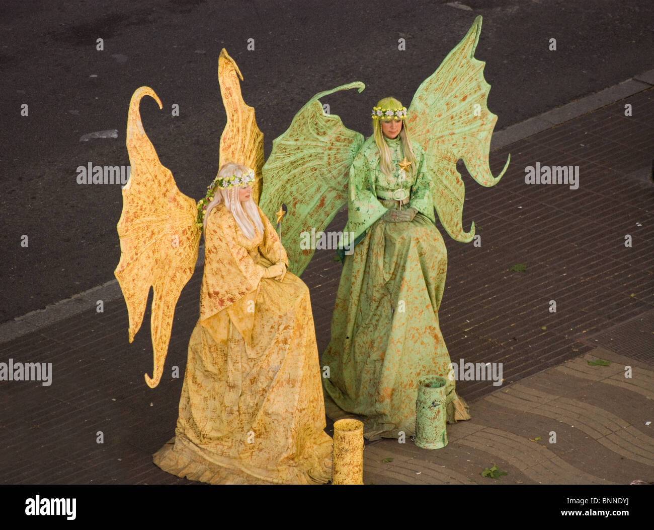 TWO FAIRIES STREET ARTISTS HUMAN STATUES IN FANCY DRESS ON LAS RAMBLAS  BARCELONA SPAIN EUROPE