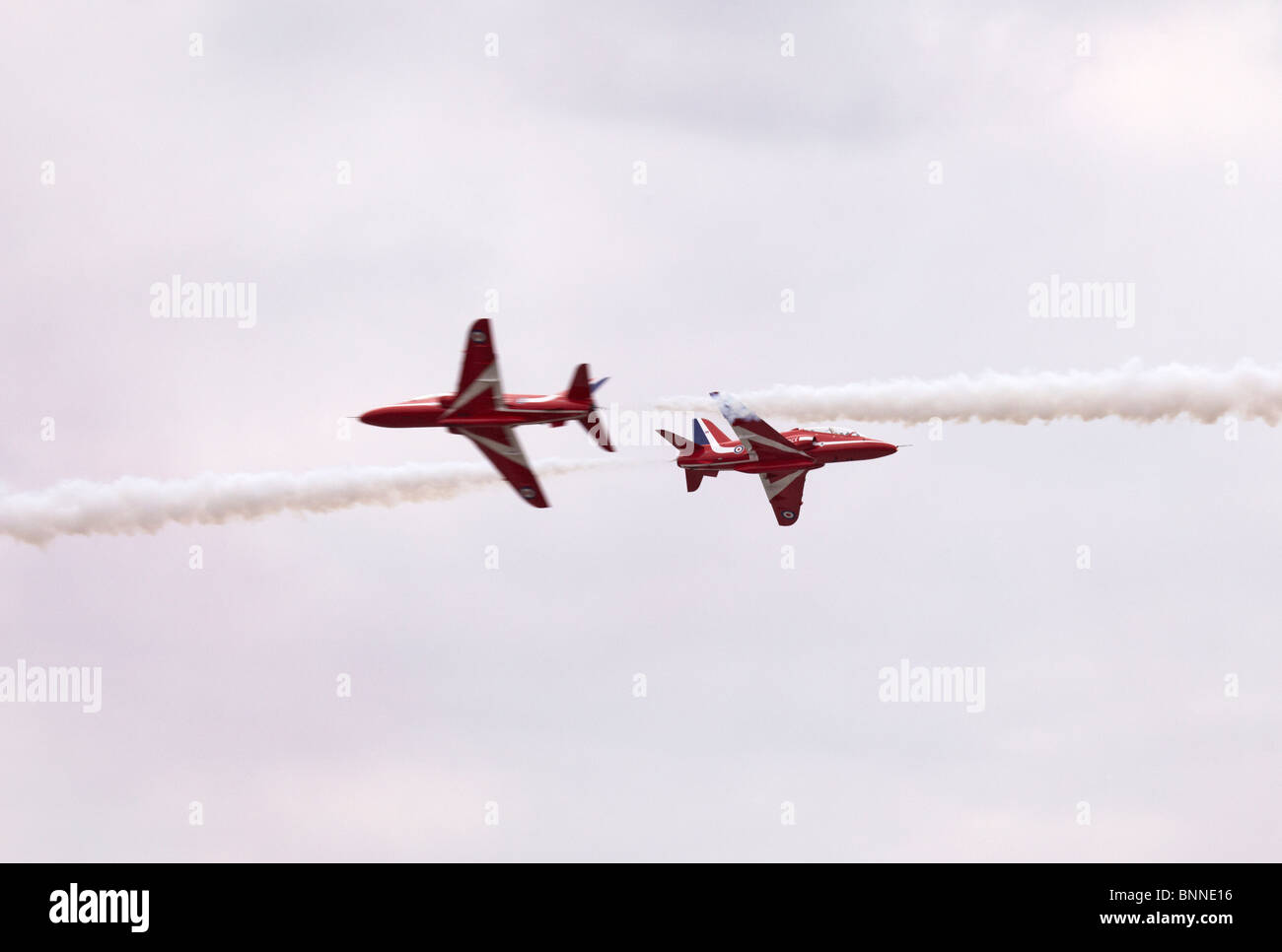 Farnborough Red Arrows RAF Hawk aerobatic display team synchro pair - Stock Image