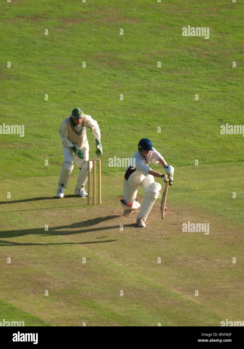 Batsman playing a shot during cricket match, Bude, Cornwall, UK - Stock Image